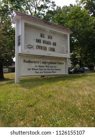 Rutherford, New Jersey / USA - July 03 2018: The sign on the lawn of the Congregational Church celebrates the US Declaration of Independence: All Men - And Women - Are Created Equal