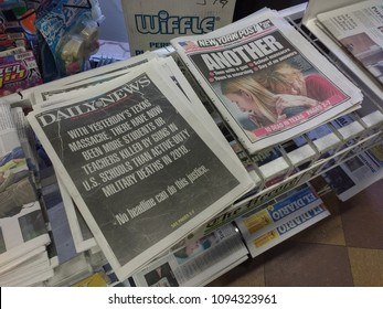 Rutherford, New Jersey / USA - May 19 2018: These were the covers of the New York Daily News and the New York Post the day after the Texas massacre at Santa Fe High School.