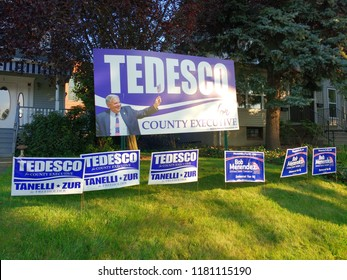 Rutherford, New Jersey / USA - September 16 2018: Huge sign supporting Tedesco for Bergen County Executive. Smaller signs endorse Tanelli and Zur for Freeholder and Bob Menendez for US Senator.