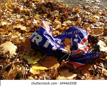 Rutherford, New Jersey/USA November 10 2016: Two days after the United States presidential election, a Trump Presidential Campaign Yard Sign is discarded in a leaf pile.