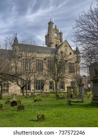 RUTHERGLEN, SCOTLAND - MARCH 24 2017: A side view of Rutherglen town hall in Scotland. This was taken inside the Old Parish church graveyard