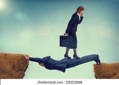 ruthless business woman walking over a rival businessman