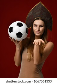 Ruusian style Fan sport woman player in kokoshnik hold soccer ball celebrating happy smiling laughing with free text copy space isolated on white background