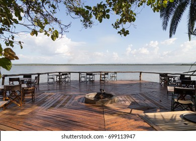 Ruzizi Tented Lodge, RWANDA - FEBRUARY 7, 2017: A raised deck overlooking Lake Ihema and towards Tanzania is where guests have breakfast and dinner while staying at the lodge.