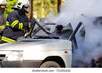 RUZOMBEROK, SLOVAKIA - SEPTEMBER 9: Firemen and burning car on September 9, 2017 in Ruzomberok