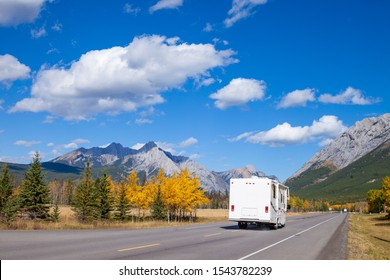 An RV aon the highway through the Canadian Rocky Mountains in Kananaskis, Alberta, Canada during the peak of autumn colors