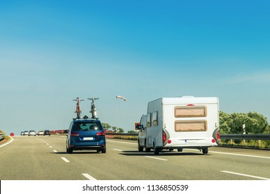 RV Camper with bicycles and car on Road. Caravan and motorhome in trip at Switzerland.