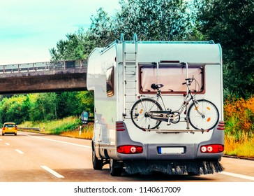 RV Camper Car with bicycle on Road. Caravan and motorhome in trip in Switzerland.