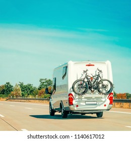RV Camper Car with bicycles on Road. Caravan and motorhome in trip at Switzerland.