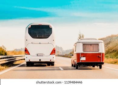 RV Camper Car and Bus on Road. Caravan and motorhome in trip in Switzerland.