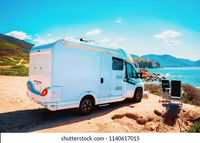 RV Camper Car at the Mediterranean Sea in Sardinia. Caravan and motorhome in trip, Italy