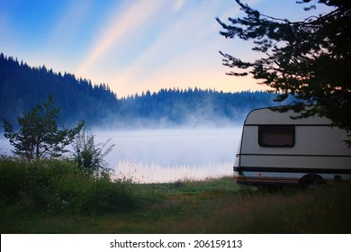 RV camper near lake, HDR sunrise in bulgarian nature