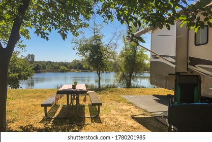 Rv camping next to the lake on a sunny summer day
