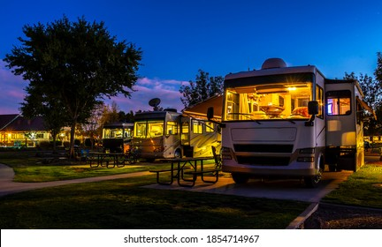 Rv camping at the water fountain in the park under a night sky