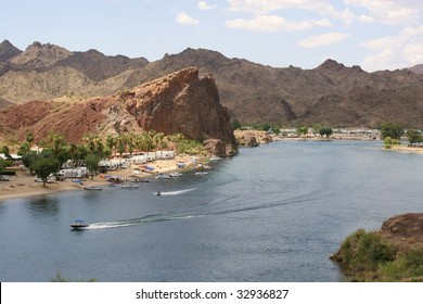 RV campsite in the lower Colorado between Lake Havasu and Parker with boat and jetski