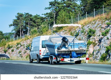 RV Car with motor boat in Road. Caravan and motor home in trip in Slovenia.