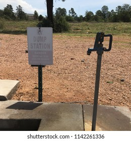 RV dump station sign with water spigot in Arizona