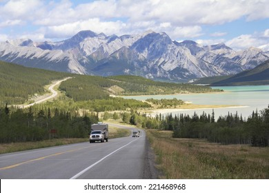 RV on a Winding Highway Next to a Mountain Lake in the Kootenay Plains - Alberta, Canada