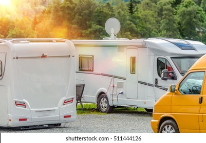 RV Park Campers. Few Motorhomes in the RV Park. Motorhome with Satellite TV Connection.