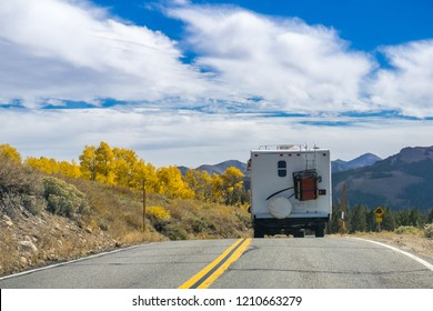 RV travelling through Sonora Pass in the Eastern Sierra mountains in autumn, California