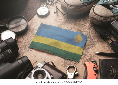 Rwanda Between Traveler's Accessories on Old Vintage Map. Tourist Destination Concept.