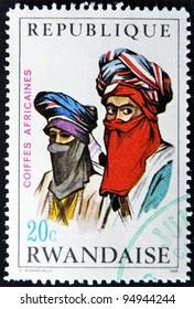RWANDA - CIRCA 1969: A stamp printed in Rwanda shows African headdresses, circa 1969