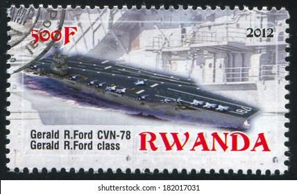 RWANDA - CIRCA 2012: stamp printed by Rwanda, shows aircraft carrier, circa 2012