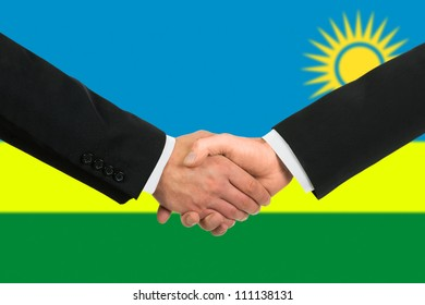 The Rwanda flag and business handshake