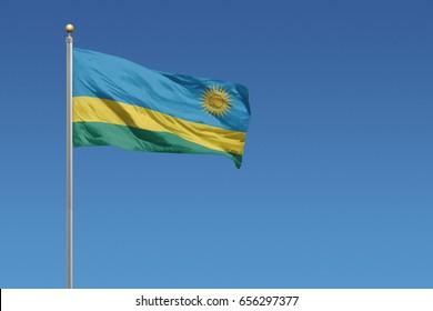 Rwanda flag in front of a clear blue sky