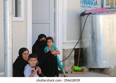 RWANGA REFUGEE CAMP, ZAKHO, KURDISTAN, IRAQ - 2015 JULY 13 - Family sitting outside their temporary home in Rwanga (rwanga refugee) camp