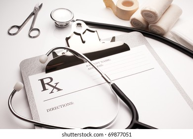 rx prescription concept stethoscope and bandages on white table