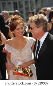 Ryan O'Neal & date at the 2009 Creative Arts Emmy Awards at the Nokia Theatre L.A. Live in Downtown Los Angeles. September 12, 2009  Los Angeles, CA Picture: Paul Smith / Featureflash