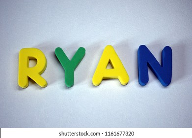 Ryan - popular boys name from colorful letters on white background. Ryan common male name.