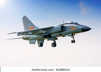 RYAZAN REGION, RUSSIA - CIRCA JULY, 2016: China Air Force Xian JH-7 FBC-1 72119 twin seater jet engine fighter bomber military jet aircraft landing on hot summer day detail exterior aerial side view
