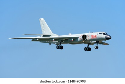 RYAZAN, RUSSIA - CIRCA AUGUST, 2018: China Air Force Xian Tupolev H-6K 20119 modern jet engine strategic nuclear capable bomber military jet aircraft landing detail front exterior isolated on blue sky