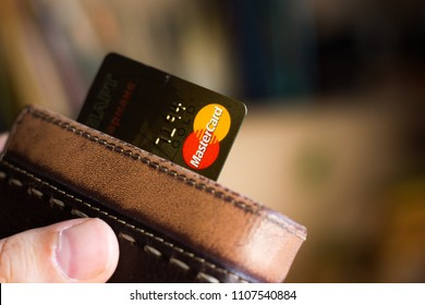 Ryazan, Russia - February 27, 2018: Mastercard gold in a leather wallet.