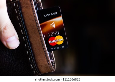 Ryazan, Russia - February 27, 2018: Credit or debit card of Mastercard brand in a leather wallet.
