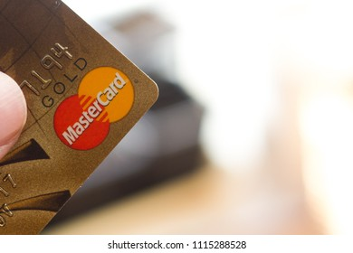 Ryazan, Russia - February 27, 2018: Customer hods Mastercard Gold ready to pay.
