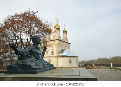 Ryazan, Russia - November 05, 2017: Monument to Sergei Yesenin on the background of the Church
