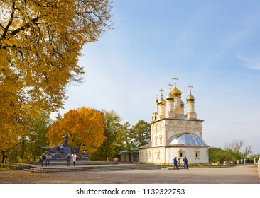 RYAZAN, RUSSIA - OCTOBER 3, 2016: Monument to Russian poet Sergei Yesenin (sculptor A. Kibalnikov, architect R. Begunts) and church of Transfiguration (Savior on the Yar)