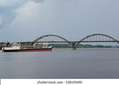 Rybinsk. The river tanker passes through Volga under the bridge