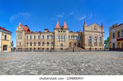 Rybinsk, Russia. Red square and exterior of historic building - former grain exchange in russian revival style