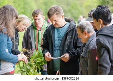Rybna nad Zdobnici, Czech Republic, 11.5.2019 - Day Of Smiles, beneficent charity happening for handicapped children. Portrait of happy smiling handicaped men learning to recognize different plants