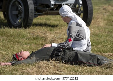 RYBNIK, POLAND - JUNE 18, 2016: Nurse kneeling over the dead german soldier who dies from air attack during WWI historical reconstruction