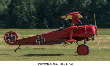 RYBNIK, POLAND - JUNE 18, 2016: Classic Red Barron Fokker Dr.1 triplane replica during historical reconstruction