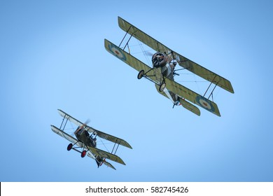 RYBNIK, POLAND - JUNE 18, 2016: Two classical planes replicas from WWI fly over airfield