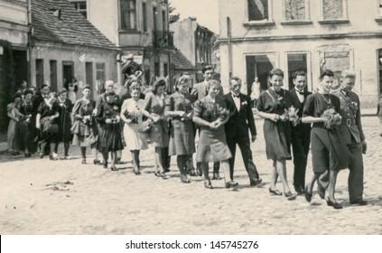 RYCHTAL, POLAND, CIRCA 18 JUNE 1946 - vintage photo of wedding procession, Rychtal, Poland, circa 18 June 1946