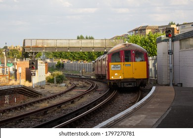 RYDE, ENGLAND - AUGUST 11 2020: An Island Line class 483 EMU arrives at Ryde Esplanade railway station with a train to Ryde Pier Head, Isle of Wight, England.