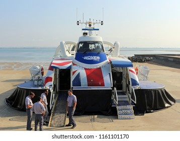 Ryde, Isle of Wight, England. 14th July 2018. A hovercraft and its crew wait for the next passengers to embark. The hovercraft travels regularly between Ryde and Southsea in Hampshire over the Solent.