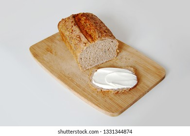 rye bread with butter on wooden board